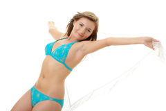 Girl in swimsuit with white scarf on wind. Royalty Free Stock Images