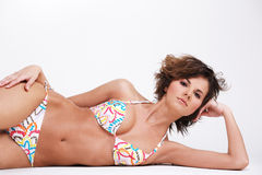 Girl in swimwear posing on white background. Royalty Free Stock Photos
