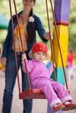 Girl on swing. Little girl on swing - shallow DOF Stock Photography