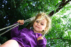 Girl in swing Royalty Free Stock Images