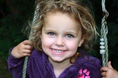 Girl in swing Stock Image