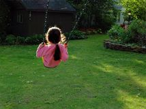 Girl on Swing Royalty Free Stock Photos