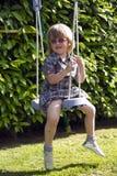 Girl swing Stock Photos