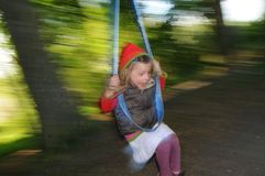 Girl on Swing Stock Images