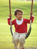 Girl on Swing. A girl on swing at park on sunny day Royalty Free Stock Images