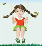 Girl on a swing. Cute girl who was riding on a swing and saw a bee Stock Images