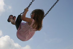 Girl on swing. In sky Stock Photo