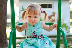 Girl on a swing Royalty Free Stock Photo