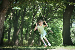 Girl on the swing. Little girl on the swing Stock Photography