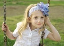 Girl on Swing. Cute little girl on a swing Royalty Free Stock Photos