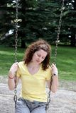 Girl on Swing. A girl on a swing looking sad Stock Image
