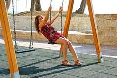 Girl on swing Royalty Free Stock Image