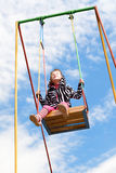 Girl on a swing Stock Images