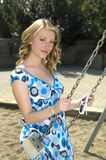 Girl on swing. Cute girl getting ready for a swing at the park Stock Image