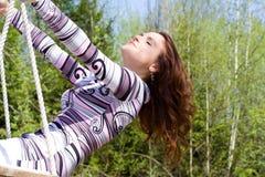 Girl at swing 3 Royalty Free Stock Image