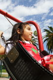 Girl on a Swing. Girl swinging around on a playground Stock Images