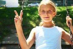 Girl in swing Stock Photos