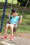 Girl on the swing. At the park Royalty Free Stock Photos