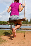 Girl on swing at beach Stock Images