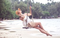 Girl on a swing on the beach of Thailand Stock Photo
