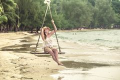 Girl on the swing on the beach of Thailand Royalty Free Stock Photo
