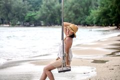 Girl on the swing on the beach of Thailand Royalty Free Stock Photography