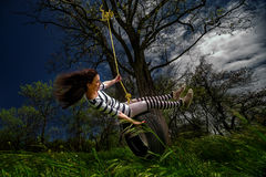 Girl on the swing. Beautiful girl on the swing in the forest Royalty Free Stock Photos