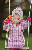 Girl and a swing Royalty Free Stock Image