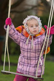 Girl and a swing Stock Images