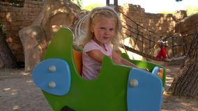 Girl on a Swing. Cute little girl riding on a swing stock video