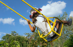Girl  on swing in the garden Stock Image