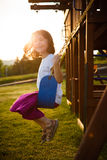 Girl on a swing. Little girl on a swing in a playground Stock Photography