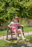 Girl on a swing Stock Photos