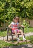 Girl on a swing Stock Photos