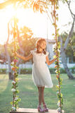 Girl on swing. Lovely preteen girl standing on swing outdoors Royalty Free Stock Photos