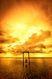 A girl on a swing over the sea at sunset in bali,indonesia 4 Royalty Free Stock Photos