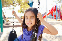 Girl On Swing In Park. Smiling Royalty Free Stock Image