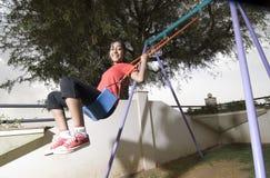Girl swing in park. Girl swings in the park Royalty Free Stock Images