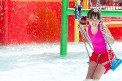 Girl on swing in pool Royalty Free Stock Images