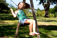 Girl on swing Royalty Free Stock Images