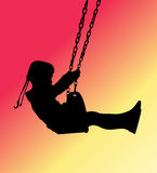 Girl on a swing silhouette Royalty Free Stock Images