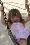 Girl on swing with smile Stock Photos