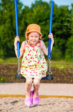 Girl and swing Royalty Free Stock Images