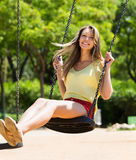 Girl on swing in summer Royalty Free Stock Photos