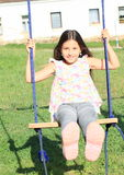 Girl on swing Stock Photo