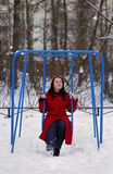 Girl on swing in winter Stock Photography