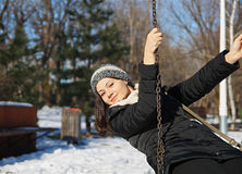 Girl on swing in winter Stock Image