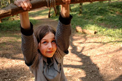 Girl on swing in the woods. Outdoor image of girl swinging in the woods Royalty Free Stock Photography