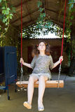 Girl on swing in yard Stock Photography