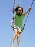 Girl Swinging. At a park, motion blur Royalty Free Stock Photos